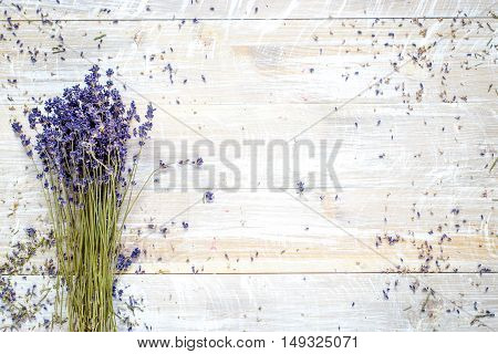 bouquet of dried lavender a wooden table top view - space for text