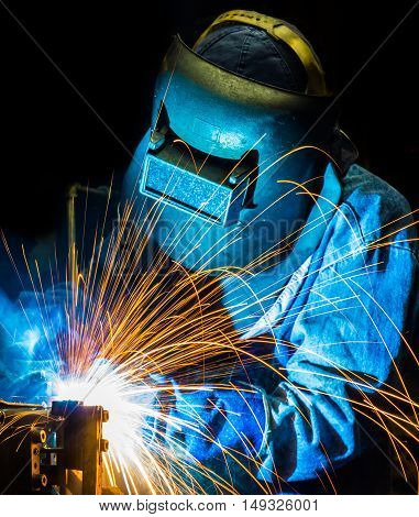 welder welding  Industrial automotive part in car production factory. in night