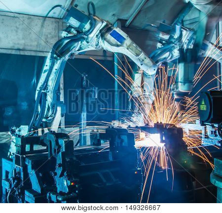 The Robots welding  movement in a car production factory