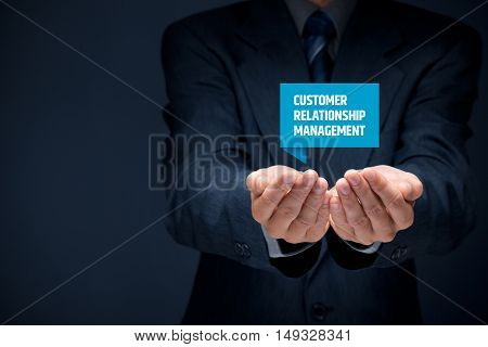 Businessman hold virtual label with Customer Relationship Management text.