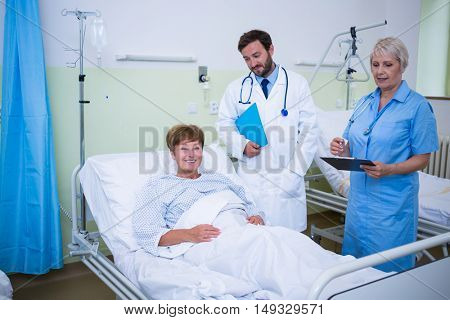Doctor talking to a senior patient in hospital room