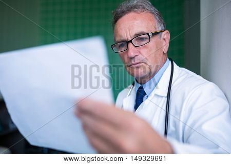 Doctor examining a report in hospital