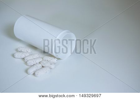Close-up of tablets spilled on table in pharmacy