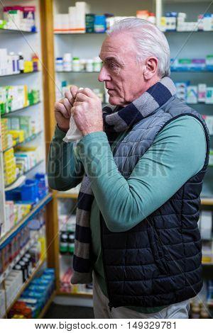 Customer checking medicines in pharmacy