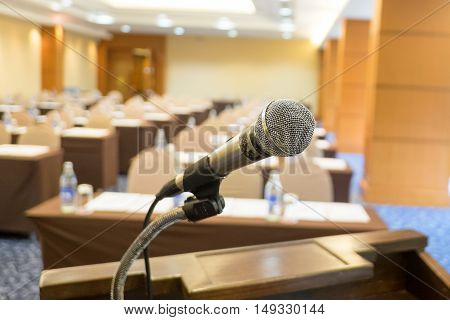 Close up microphone at seminar room background