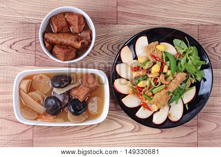 Chinese Vegetable festival  food as fried ginkgo with mixed vegetables served with brown soup  and  streamed Chinese medicine herb soup,
