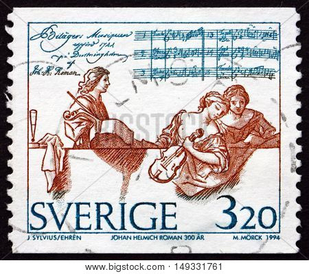 SWEDEN - CIRCA 1994: a stamp printed in Sweden shows Johan Helmich Roman Swedish Baroque Composer circa 1994