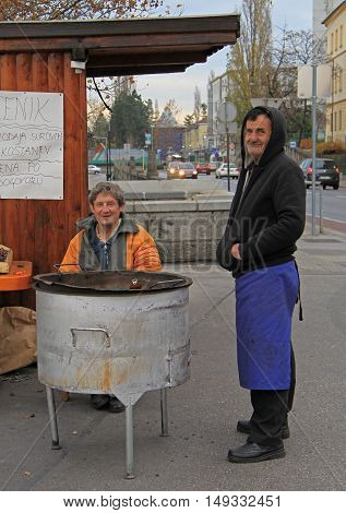 Man Is Selling Roasted Chestnuts In The Kiosk In Maribor, Slovenia