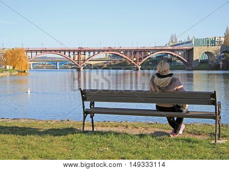 Woman Is Resting On A Bench In Maribor