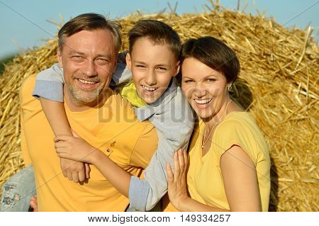 Happy family with  son at the wheat field