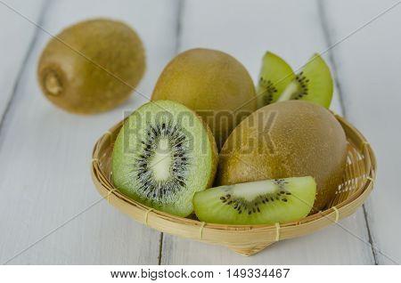 Kiwi Fruit And Sliced With Bamboo Basket