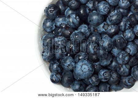 Blueberries in a white bowl isolated on white background. The concept of summer berry crops, organic food, vitamins