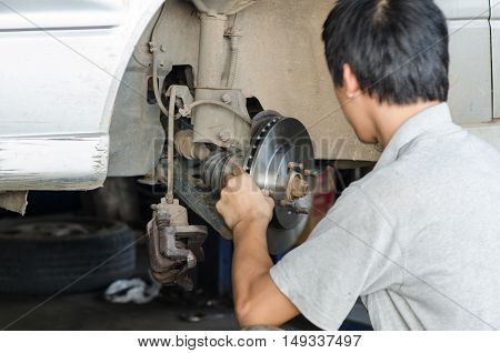 An image of changing brake disc with technician