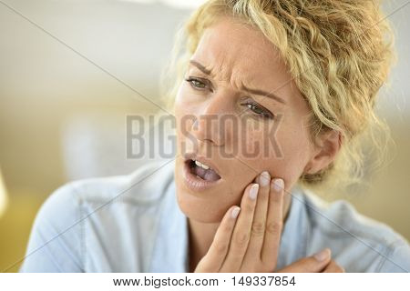 Middle-aged woman suffering toothache