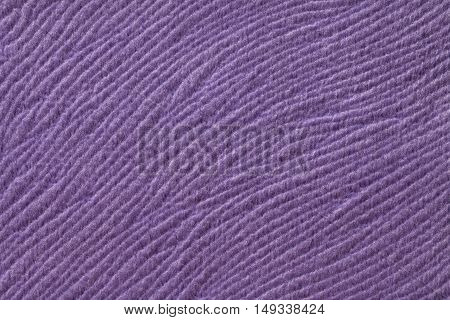 Purple background from a soft wool textile material closeup. Fabric with natural texture. Cloth backdrop.