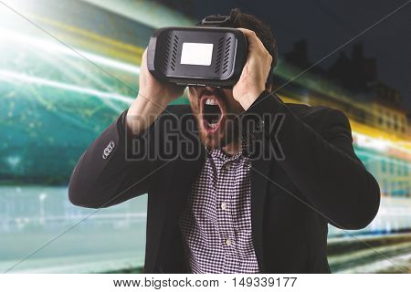Attractive man with virtual reality glasses in the city