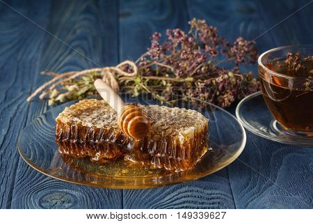 Herb Hypericum Oregano And Honey On Wooden Background