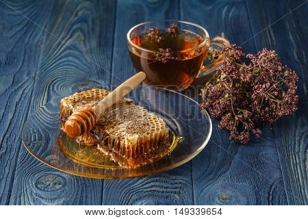 Wildflower Honey On Wooden Table Next To Honeycomb With Honey Dipper