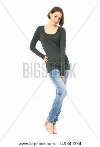 Portrait Of Girl Standing In Jeans In The Studio