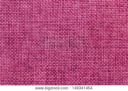 Purple textile background closeup. Structure of the fabric macro.