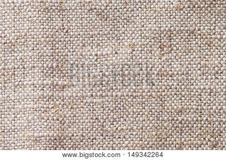 Light beige textile background closeup. Wicker structure of the fabric macro.