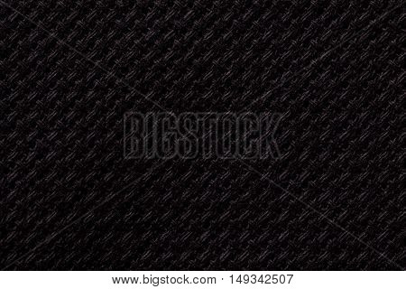Black textile background closeup. Structure of the fabric macro.