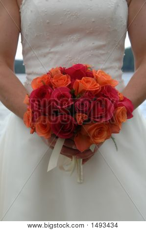 White Wedding Dress Holding Bouquet
