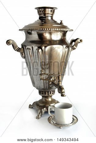Vintage metal tea samovar with a cup ion white background