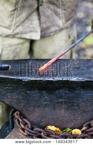 Red Hot Glowing Steel Rod On Anvil
