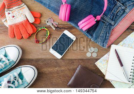Travel accessoriesGloves earphones smart phones jeans notebooks pens shoes wallet for trip
