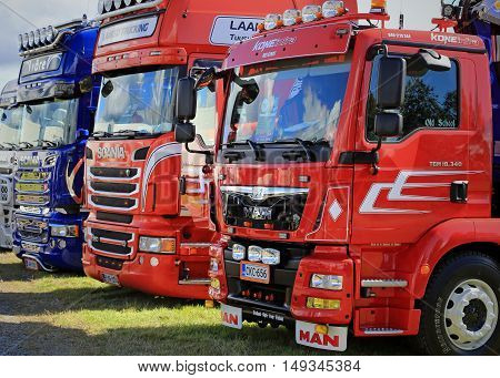 ALAHARMA FINLAND - AUGUST 12 2016: Group of MAN and Scania show trucks displayed on the annual Power Truck Show 2016 detail.