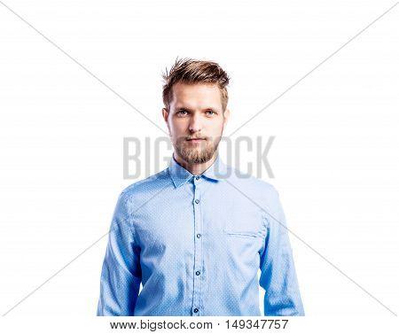 Hipster man in light blue long-sleeved shirt, studio shot on white background, isolated