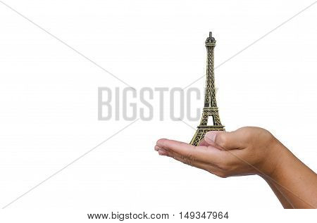 Open hand with a model the Eiffel Tower on white background.
