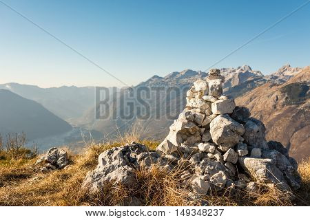 Pile of stones. Rock pile on mountain top with blurred background.