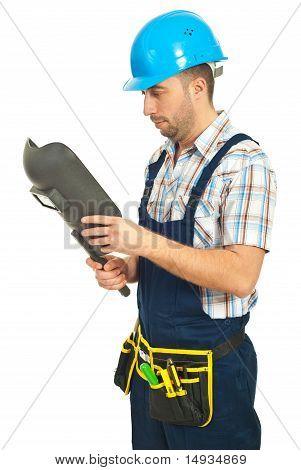 Welder Checking His Welding Mask