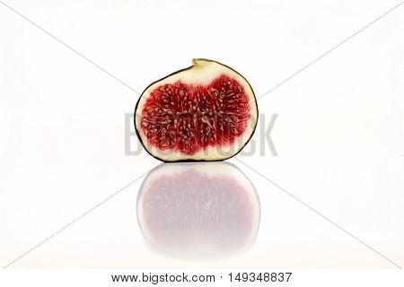 Fresh Figs Isolated On White With Reflection