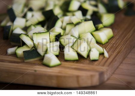 Close Up On Zucchini Pieces On Wood