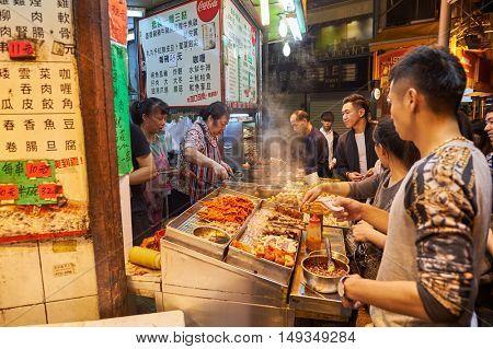 HONG KONG - 25 DECEMBER 2015: street cafe in Kowloon at night. Kowloon is an area in Hong Kong comprising the Kowloon Peninsula and New Kowloon.