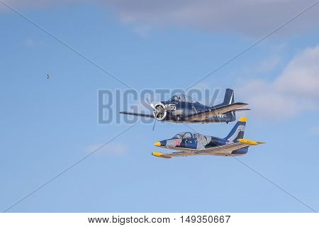 BLOEMFONTEIN SOUTH AFRICA - JULY 16 2016: An Aero L-39 Albatros and T 28 Trojan flying in formation in a public display at the Tempe Airport at Bloemfontein