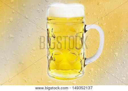 Nice Beer mug on yellow background Drop.