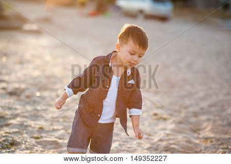 Boy running along the beach and shouts of happiness