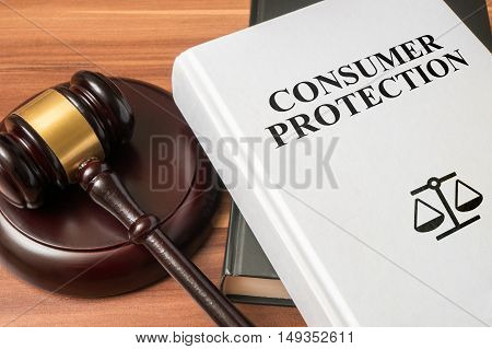 Consumer Protection Book And Gavel. Law And Regulations Concept.