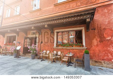 Cozy red outdoor cafe in Warsaw, Poland