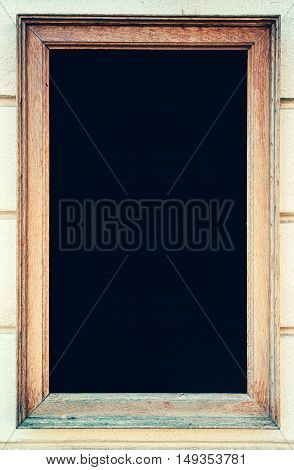 Rustic wooden frame with black chalkboard as copy space for cafe bar or restaurant menu text or graphics