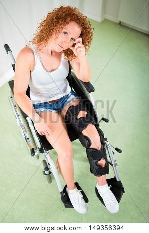 Woman In Shorts And T-shirt Seated In Wheelchair