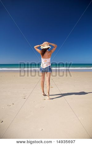 Holding On Straw Hat At Beach