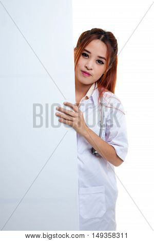 Young Asian Female Doctor Peeking From Behind Blank Sign Billboard.