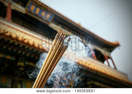 Close up of burning incense sticks in a pagoda, Beijing, China