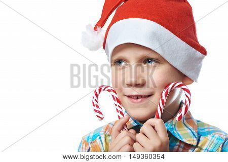 Little Boy In New Year's Red Cap With Christmas Candy Canes Isolated
