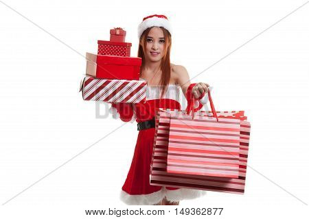 Asian Christmas Santa Claus Girl With Shopping Bags And Gift.